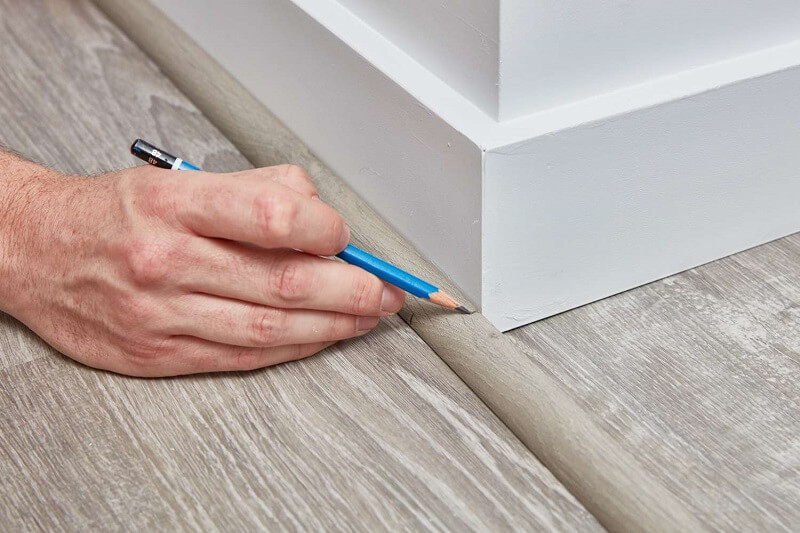 Cut the quarter round to fit the length of the floor and wall