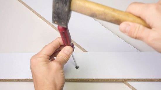 Remove the stuck screw with a hammer