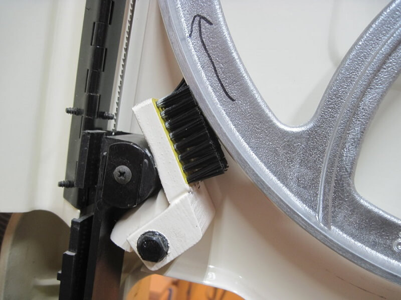 Use a bandsaw brush to clean the tire