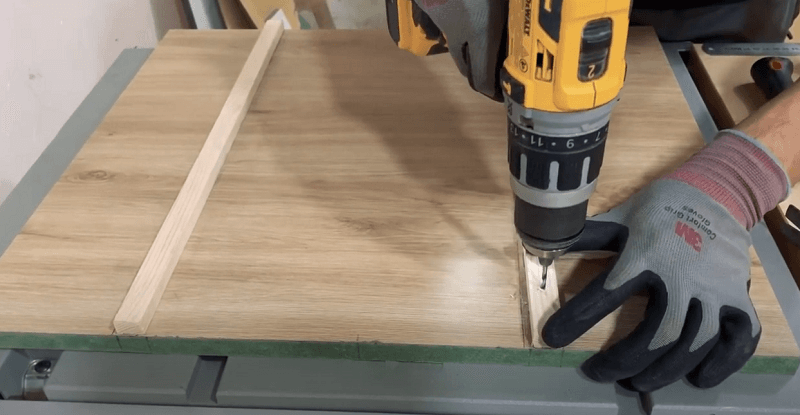 Using drill and screw to fasten plywood sled base and track